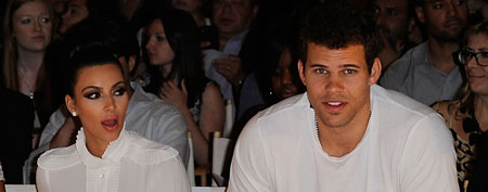 Kim Kardashian, and Kris Humphries at the Abbey Dawn by Avril Lavigne Spring 2012 fashion show on September 12, 2011 in New York City (Ilya S. Savenok/Getty Images).