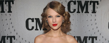 NASHVILLE, TN - NOVEMBER 29: Honoree Taylor Swift attends the 2011 CMT Artists of the year celebration at the Bridgestone Arena on November 29, 2011 in Nashville, Tennessee. (Photo by Rick Diamond/Getty Images for CMT)