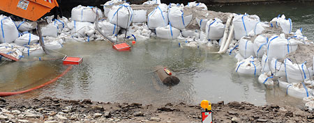 Sandbags frame a 1.8 ton WWII bomb in  the Rhine River near Koblenz Saturday Dec. 3, 2011. Officials in Germany's western city of Koblenz say some 45,000 residents have had to be evacuated. (AP Photo/dapd/ Harald Tittel)