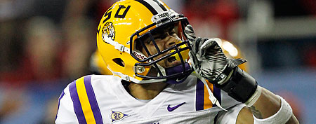 LSU cornerback Tyrann Mathieu (7) reacts to a fumble recovery against Georgia during the second half of the Southeastern Conference championship NCAA college football game, Saturday, Dec. 3, 2011, in Atlanta. (AP Photo/Dave Martin)