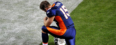 Denver Broncos quarterback Tim Tebow (15) kneels in prayer before the start of the first quarter against the New York Jets Denver Broncos at Sports Authority Field. (Ron Chenoy-US PRESSWIRE)