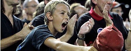 A young, unidentified fan cheers his team. (AP Photo/Ross D. Franklin)