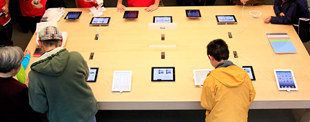 Customers look at the Apple iPad 2 on display at an Apple Store in San Francisco, Friday, Nov. 25, 2011. (AP)