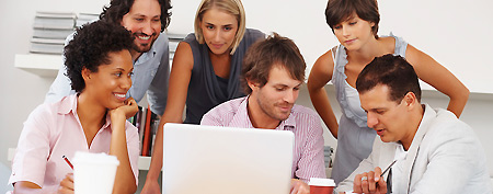 Team works on a business plan. (ThinkStock)