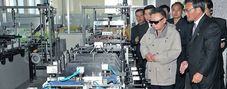 North Korean leader Kim Jong Il inspects a plastic goods factory in Pyongyang. (AFP Photo/Kns)