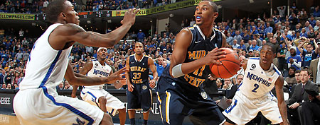 MEMPHIS, TN - DECEMBER 11: Joe Jackson #1 and Antonio Barton #2 of the Memphis Tigers apply the press against Donte Poole #11 of the Murray State Racers on December 11, 2011 at FedExForum in Memphis, Tennessee. Murray State beat Memphis 76-72. (Photo by Joe Murphy/Getty Images)