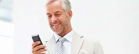 Man using cell (ThinkStock)