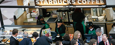 A crowd gathers at a Starbucks. (AP Photo/Mark Lennihan)