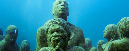 Figures are seen in an underwater sculpture park between Cancun and Isla Mujeres December 11, 2010. The sculptures created by British artist Jason de Caires Taylor.  (REUTERS/Jorge Silva)