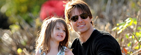 Suri Cruise and Tom Cruise.  (Photo by James Devaney/WireImage)