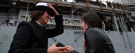 Petty Officer 2nd Class Marissa Gaeta, left, greets her girlfriend of two years, Petty Officer 3rd Class Citlalic Snell at Joint Expeditionary Base Little Creek in Virginia Beach, Va., Wednesday, Dec. 22, 2011.(AP Photo/The Virginian-Pilot, Brian J. Clark)