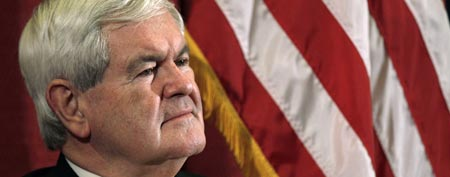 Republican presidential candidate former House Speaker Newt Gingrich, listens as he is introduced during a campaign stop in Manchester, N.H., Wednesday Dec. 21, 2011. (AP Photo/Charles Krupa)