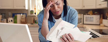 Upset woman in kitchen (Thinkstock)