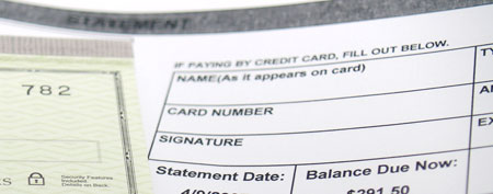 Bank statement and check book.  (iStockphoto)