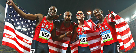 LaShawn Merritt, Angelo Taylor, Jeremy Wariner and David Neville of the United States hold their countries flag after winning the gold medal in the Men's 4 x 400m Relay held at the National Stadium on Day 15 of the Beijing 2008 Olympic Games on August 23, 2008 in Beijing, China. (Photo by Alexander Hassenstein/Bongarts/Getty Images)