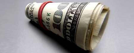 Roll of cash (Corbis)