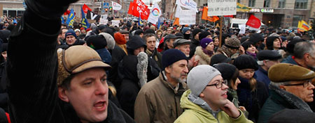 Protestors shout slogans during a demonstration against recent parliamentary election results in St. Petersburg December 24, 2011. (REUTERS/Alexander Demianchuk)