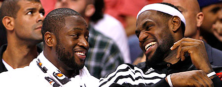 Miami Heat guard Dwyane Wade, left, and forward LeBron James share a laugh. (AP Photo/Wilfredo Lee)