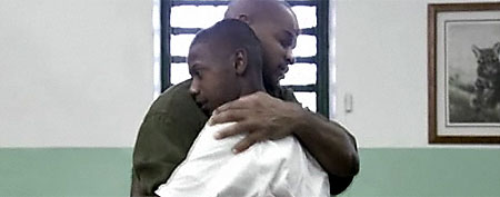 Derrick Brown and his father embrace. (Screen grab courtesy of ESPN)