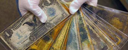Currency, part of the artifacts collection of the Titanic, is shown at a warehouse in Atlanta, in this Aug 15, 2008 file photo. (AP Photo/Stanley Leary, File)