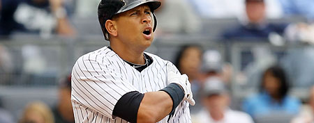 Alex Rodriguez #13 of the New York Yankees grimaces after aggravating his injured shoulder. (Photo by Jim McIsaac/Getty Images)