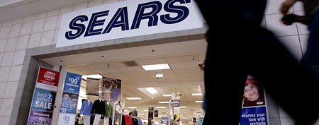 Customers walk into a Sears store. (AP Photo/Paul Sakuma)