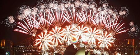 Fireworks explode over the Sydney Harbour Bridge and Opera House during a pyrotechnic show to celebrate the New Year January 1, 2012. (REUTERS)