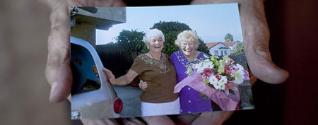 In this Dec. 28, 2011 photo 100-year-old Minka Disbrow shows a photo of her, right, and her daughter Ruth Lee taken   the day they first reunited in 2006, during an interview with the Associated Press in San Clemente, Calif. (AP)