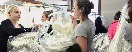 Brides-to-be scoured through the aisles at Priscilla of Boston's final warehouse sale. (Wendy Maeda/The Boston Globe via Getty Images)
