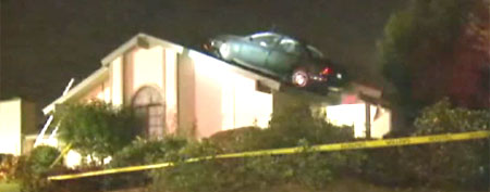 Car on roof of Fresno, Calif. home (ABC)