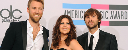 Musicians  Charles Kelley, Hillary Scott and David Haywood of Lady Antebellum, winners of Favorite Country Band/Duo/Group Award, pose in the press room at the 2011 American Music Awards held at Nokia Theatre L.A. LIVE on Nov. 20, 2011, in Los Angeles. (Photo by Jason Merritt/Getty Images)