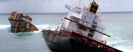 Cargo ship Rena is split in two and sits on a reef near Tauranga, New Zealand (AP/Maritime New Zealand)
