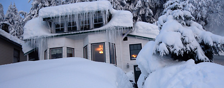 3. A house is buried in snow in the fishing town of Cordova, Alaska (AP Photo/Alaska Division of Homeland Security and Emergency Management, Erv Petty)