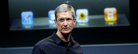 Apple Chief Executive Tim Cook speaks about the iPhone 4S at the Apple headquarters in Cupertino, California in this October 4, 2011 file photo. (REUTERS/Robert Galbraith)