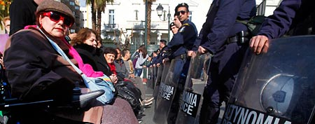 People with disabilities protest in front of a police cordon during a demonstration against austerity measures in   Athens December 13, 2011. (REUTERS/Yannis Behrakis)