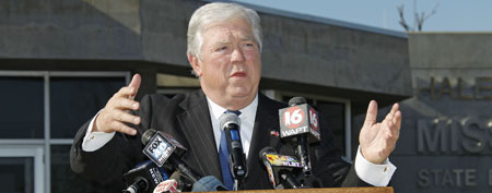 Gov. Haley Barbour says he's sharing the honor of having the state emergency operations center named for him with the people who responded to hurricanes, floods, tornadoes and other disasters, Thursday, Jan. 5, 2012 during naming ceremonies in Pearl, Miss. (AP Photo/Rogelio V. Solis)