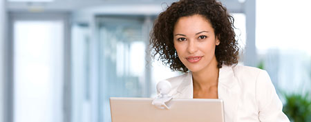 Woman using laptop (Thinkstock)