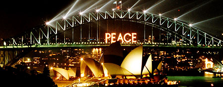 The letters PEACE are displayed on the Sydney Harbour Bridge and over the Opera House during celebrations to welcome in the new year Wednesday, Jan. 1, 2003. (AP Photo/Russell McPhedran)