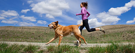 Woman running with her dog (Getty Images)