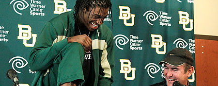 Baylor coach Art Briles, right, laughs as Heisman Trophy winner Robert Griffin III shows off his socks during a news conference where Griffin announced that he will skip his senior season to enter the NFL draft, Wednesday, Jan. 11, 2012, in Waco, Texas. (AP Photo/Tony Gutierrez)