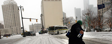 A man navigates through the snowy streets in Detroit, Michigan. (Spencer Platt/Getty Images)