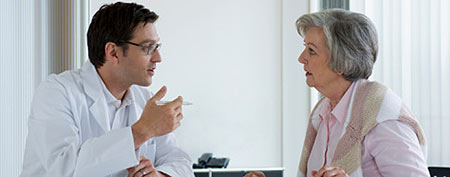 Doctor consulting with patient (Thinkstock)