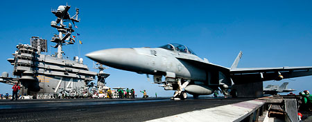 In this photo released by the U.S. Navy, an F/A-18F Super Hornet from the Black Aces of Strike Fighter Squadron (VFA) 41 launches off the flight deck of the aircraft carrier USS John C. Stennis (CVN 74) in the Arabian Sea Tuesday, Jan. 3, 2012. (AP Photo/U.S. Navy, Mass Communication Specialist 3rd Class Kenneth Abbate)