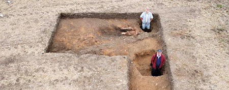 The archaeological team inside the postholes from the later Roman building (William Bowden via LiveScience)