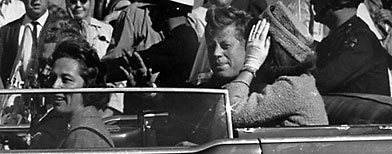 President John F. Kennedy is seen riding in motorcade approximately one minute before he was shot in Dallas, Tx., on Nov. 22, 1963. (AP photo)