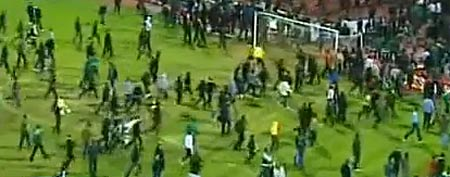 Fans storm the field at an Egyptian soccer  (Y! Sports screengrab)