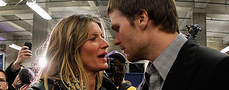 Tom Brady #12 of the New England Patriots chats with his wife Gisele Bundchen after losing to the New York Giants by a score of 21-17 in Super Bowl XLVI at Lucas Oil Stadium on February 5, 2012 in Indianapolis, Indiana. (Photo by Rob Carr/Getty Images)