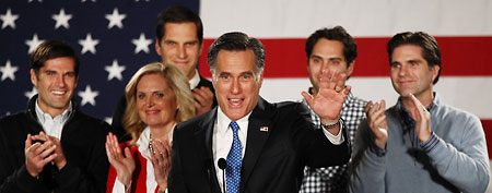 Mitt Romney with his family at a campaign event (AP)