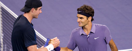 Roger Federer of Switzerland shakes hand with John Isner of USA (Photo by Victor Fraile/Getty Images)