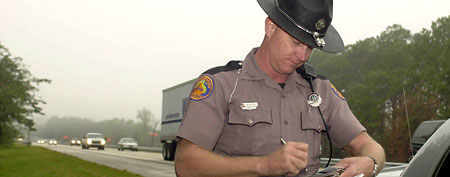 Highway Patrol officer writing a ticket. (AP Photo/Peter Cosgrove)